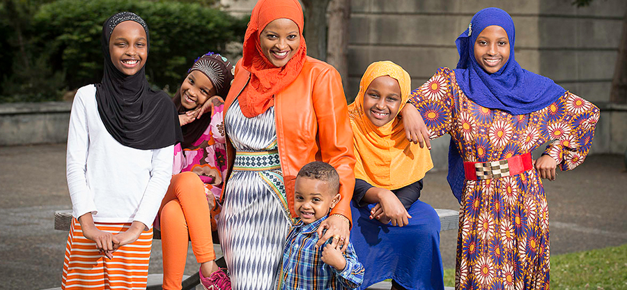 Student Zam and her family smiling