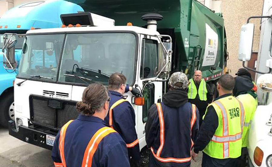 SSC Diesel & Heavy Equipment Instructor Jeremie Pitts discussing the newly donated truck with students at South Seattle College (photo courtesy of Waste Management)